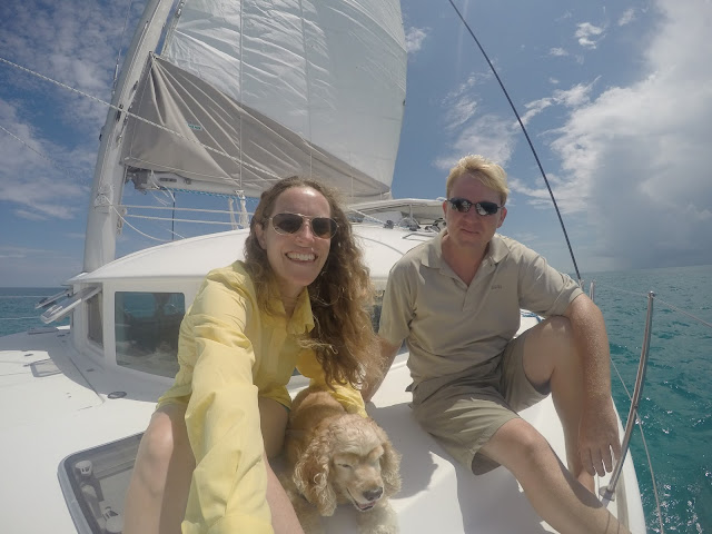 Couple with dog on their Lagoon 380 sailing catamaran in the Florida Keys