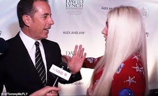 Jerry Seinfeld and Kesha hug