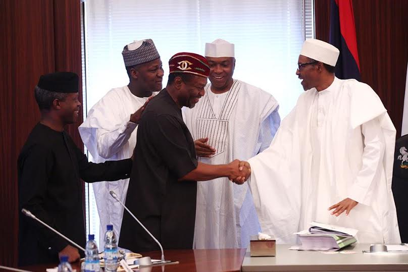 2 Photos: President Buhari signs the 2016 Budget