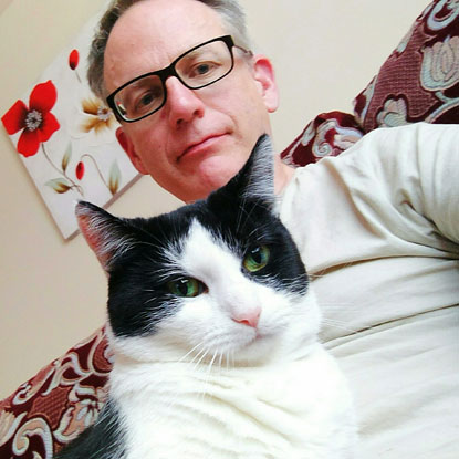 Paul Willis and Pebbles the cat
