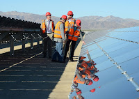 U.S. Interior Secretary Sally Jewell and other federal officials inspecting solar panels at the Desert Sunlight Solar Farm on federal lands in California in 2015. (Credit: U.S. Dept. of Interior/flickr) Click to Enlarge.