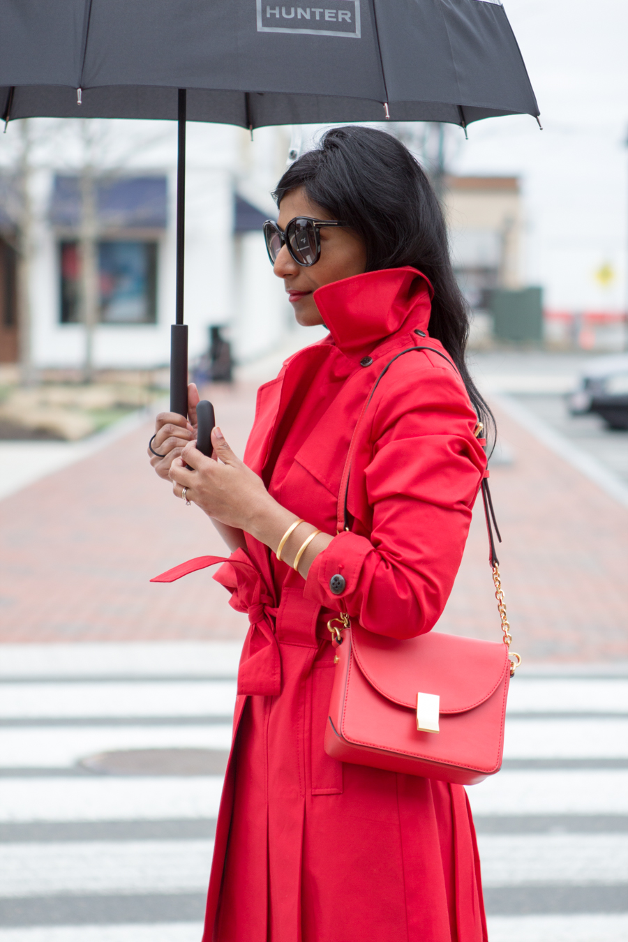 rainy day style, trench coat, red coat, raincoat, single-breasted trench, bright red coat, petite raincoat, red bag, cross-body bag, flynn, hunter, rainwear, mommy style, mom style, elegant look, chic, street style, white pumps, polka dot skirt