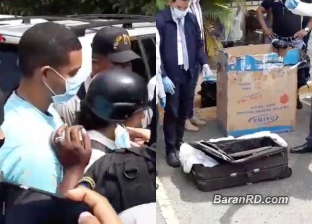 Marlon y Marlin Martínez observan la maleta donde fue hallado el cadáver de Emely