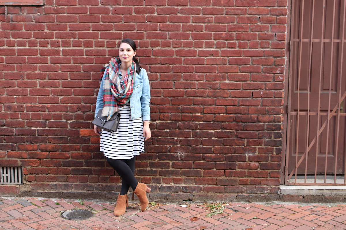 This is a fashion shoot of my outfit rocking a black and white striped dress, booties, a plaid scarf and a denim jacket.