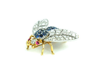 This plattinum diamond sapphire brooch would certainly create a buzz. From Lucie Campbell London