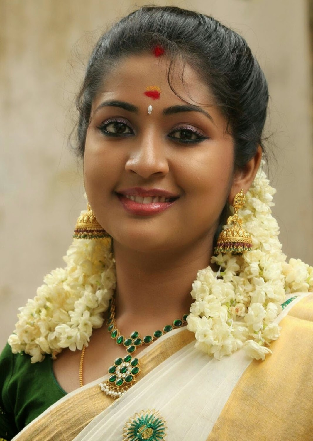 Actress Navya Nair Smiling Stills In White Saree