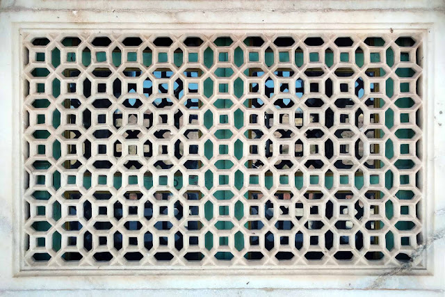 Intricately carved marble jali window