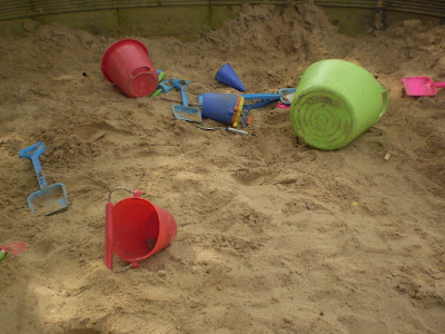 Buckets and spades on sand