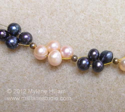 Navy and peach freshwater pearl strung in a cluster pattern