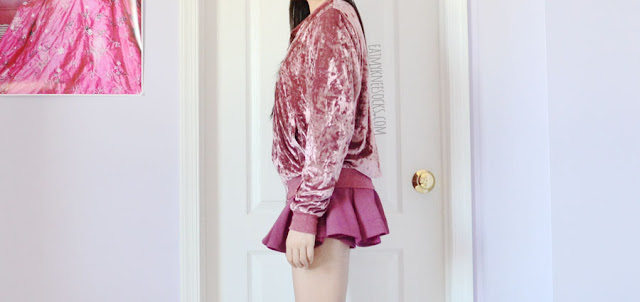 Pink mauve crushed velvet bomber jacket from SheIn, worn with white crop top and Japanese Snidel brand pink-purple flared skort.