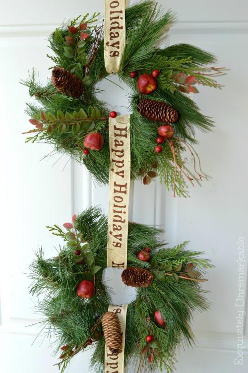 Two Evergreen wreaths hanging on Front door