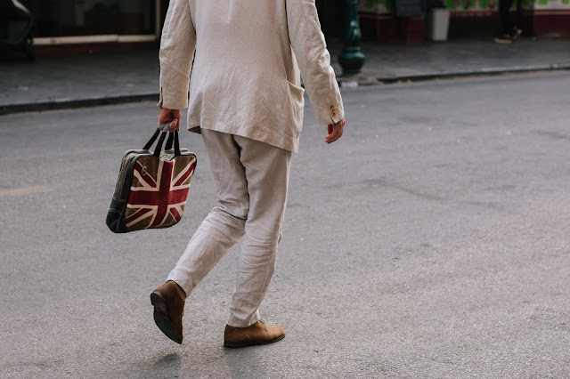 man with Union Jack flag bag Photo by quan le on Unsplash