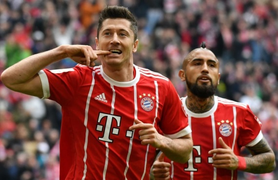 Robert Lewandowski and Arturo Vidal celebrate a goal for Bayern Munich