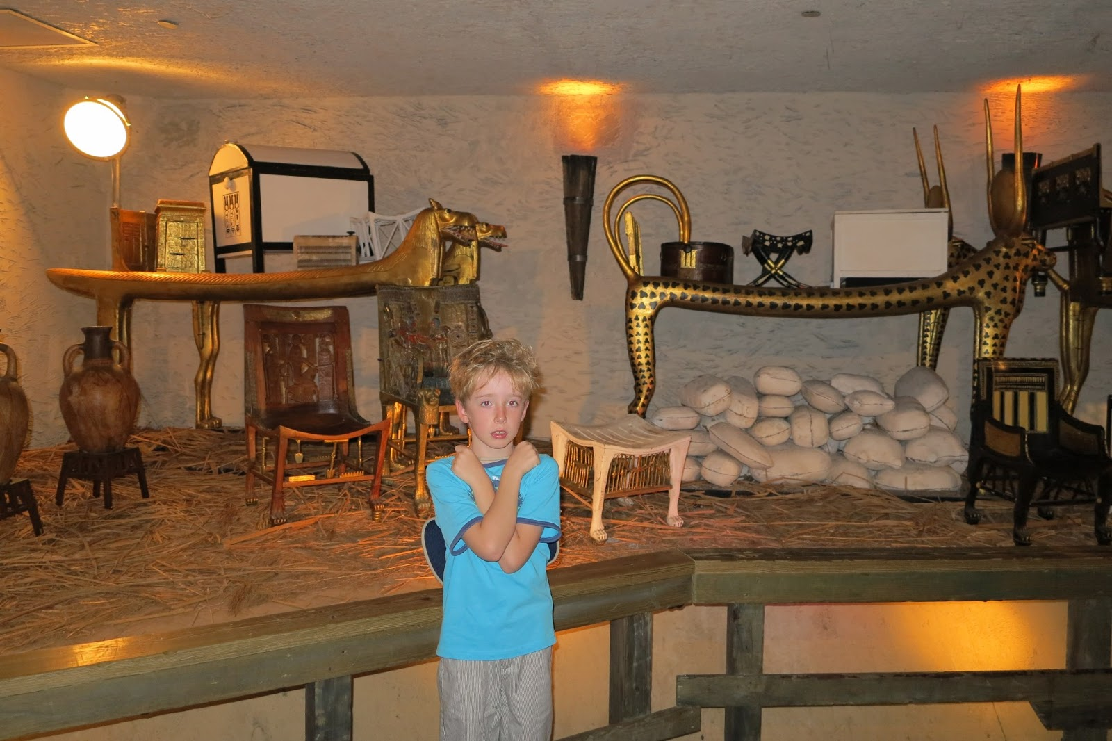 King Tut s sarcophagus  the golden coffin  and replica mummy inside King Tuts Tomb Inside