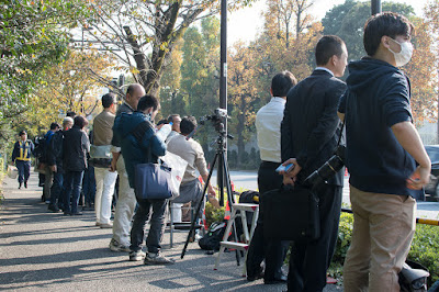 Waiting for Donald Trump to appear, at the East Gate of the Akasaka State Guest House, Tokyo, Japan.