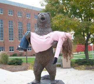 bear statue holding a female