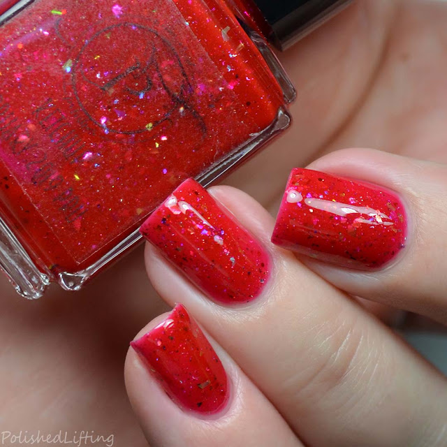 red nail polish with flakies