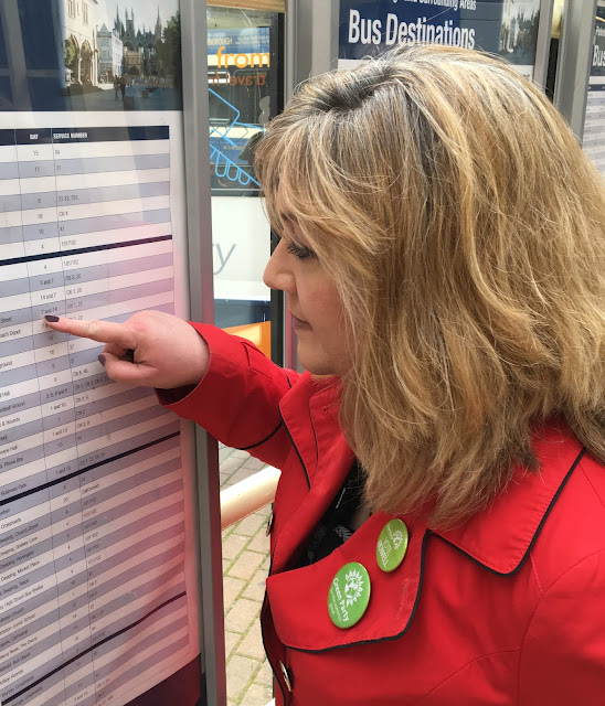 Julie reading a bus timetable