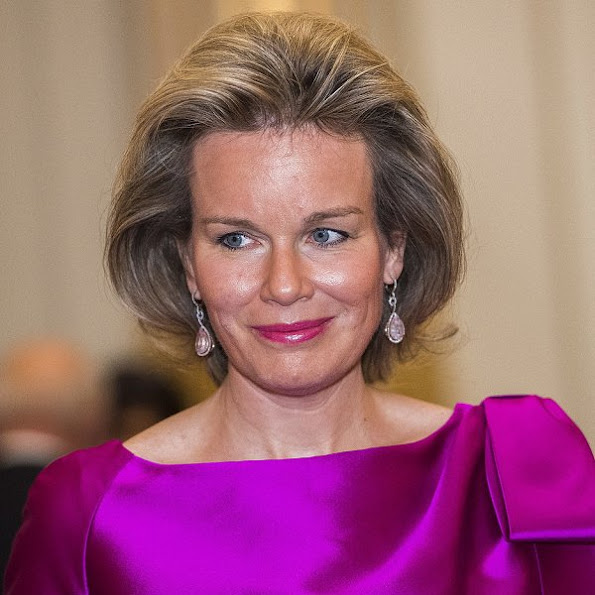 Queen Mathilde and King Philippe, Prince Lorenz and Princes Astrid of Belgium at Autumn Concert 2016 Queen Mathilde wore Natan dress Prada clutch bag, diamond earring