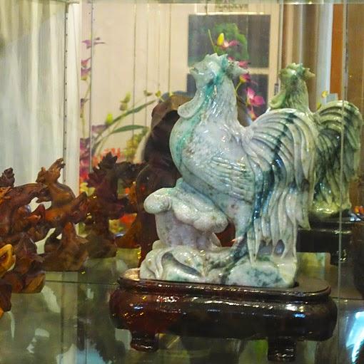 Beautiful carved chicken sculpture in white jade