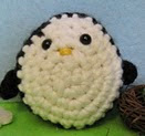 http://www.ravelry.com/patterns/library/oborocharm-amigurumi-penguin