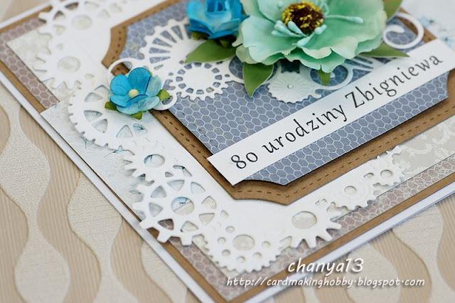 kartka ozdobiona została elementami z wykrojnika i kwiatami