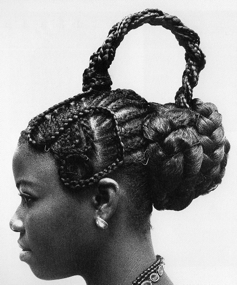 Historically, Nigerians hairstyles symbolized certain things Girl with traditional hairstyle and tribal scarring , Sirigu , Upper East