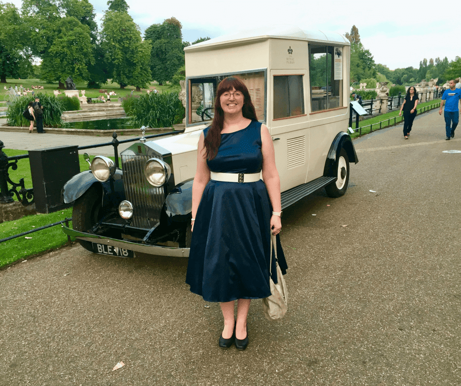 woman stands in front of Rolls Royce ice-cream van