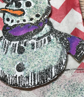 embossed snowman with a purple & pink scarf