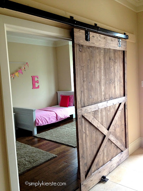 rustic barn door in girl's room
