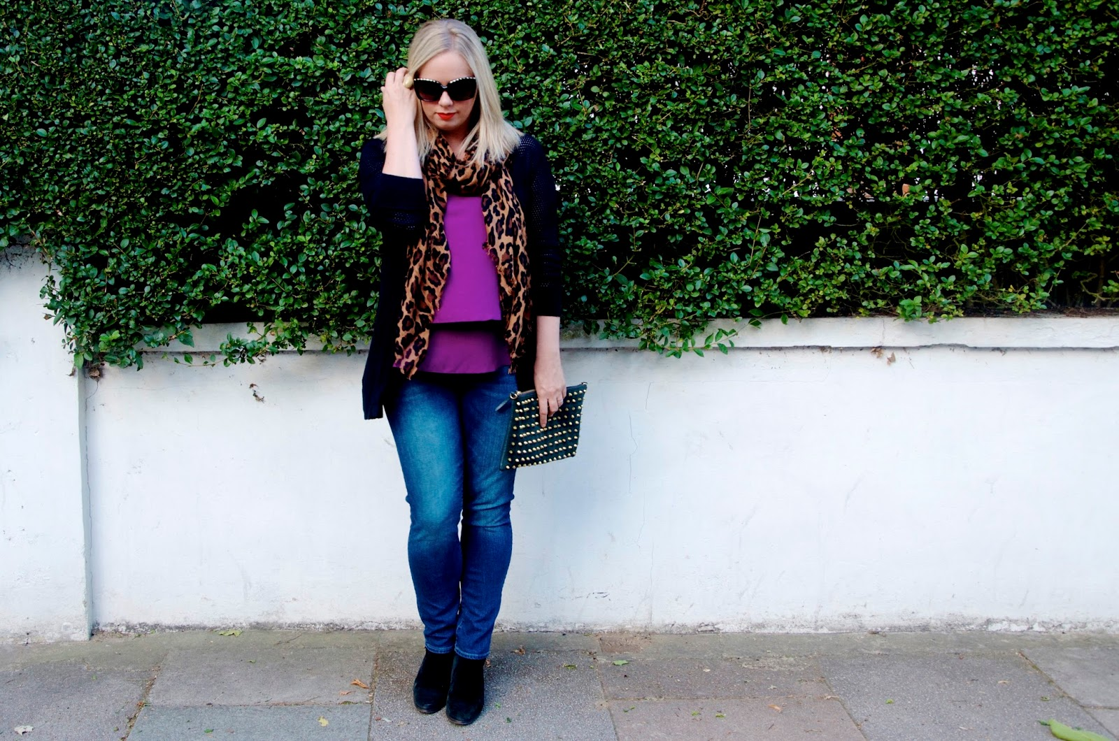 leopard print scarf, fuchsia top, studded green suede clutch