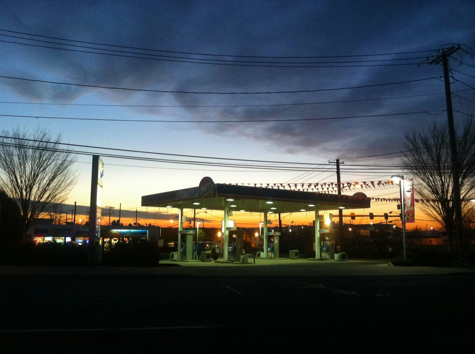 Sunset-Over-Gulf-Station-in-Farmingdale