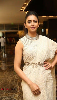 Actress Rakul Preet Singh Stills in White Dress at Winner Pre Release Function  0017.jpg