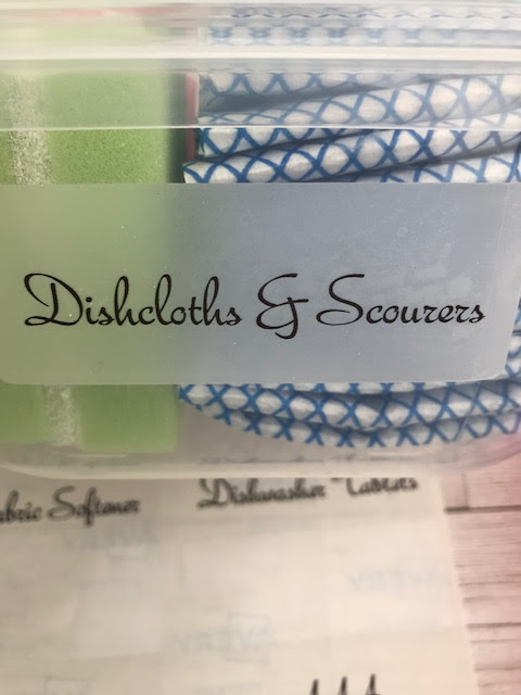 A box labelled dishcloths and scourers