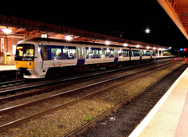 A night photo of a Chiltern Railways Class 159 DMU at Leamington Spa station.  This class of dmu will take over from the Class 121 bubble cars