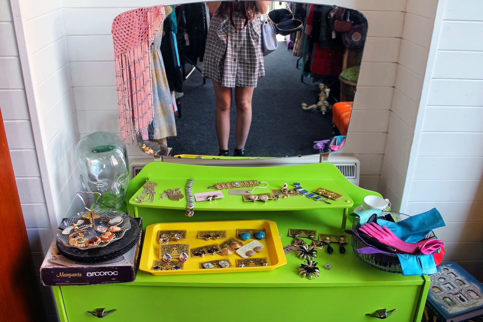 lime green retro dressing table with vintage accessories and jewellery