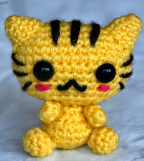 http://www.craftsy.com/pattern/crocheting/toy/cute-little-cat/101803