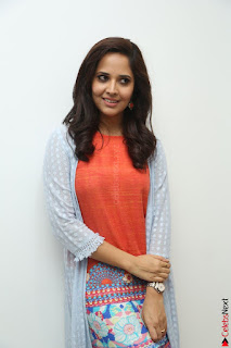 Actress Anasuya Bharadwaj in Orange Short Dress Glam Pics at Winner Movie Press Meet February 2017 (86).JPG