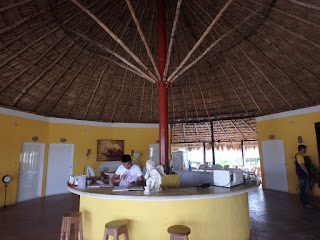 Reception area with large palm thatched roof