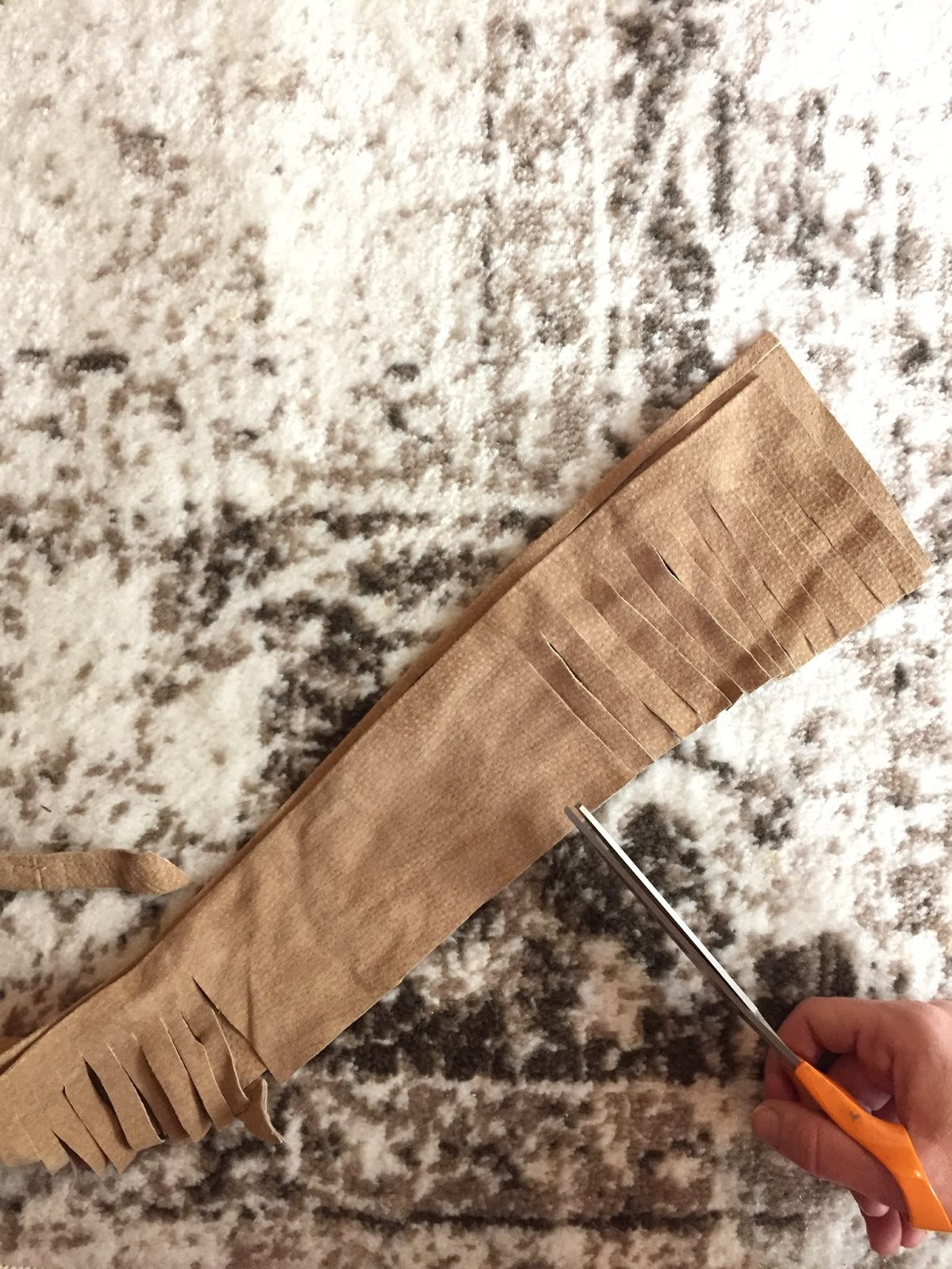 Hostess gifts: Make a suede tassel from scraps.