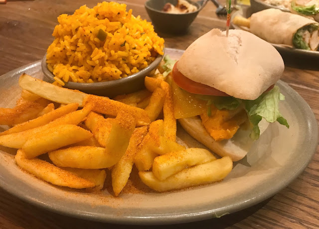 chicken burger, chips and spicy rice at nandos