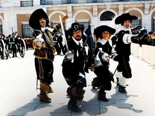 Porthos (Frank Finlay), Athos (Oliver Reed), d'Artagnan (Michael York) and Aramis (Richard Chamberlain