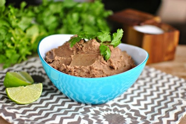 The BEST Slow Cooker Refried Beans from Food Bloggers featured on SlowCookerFromScratch.com