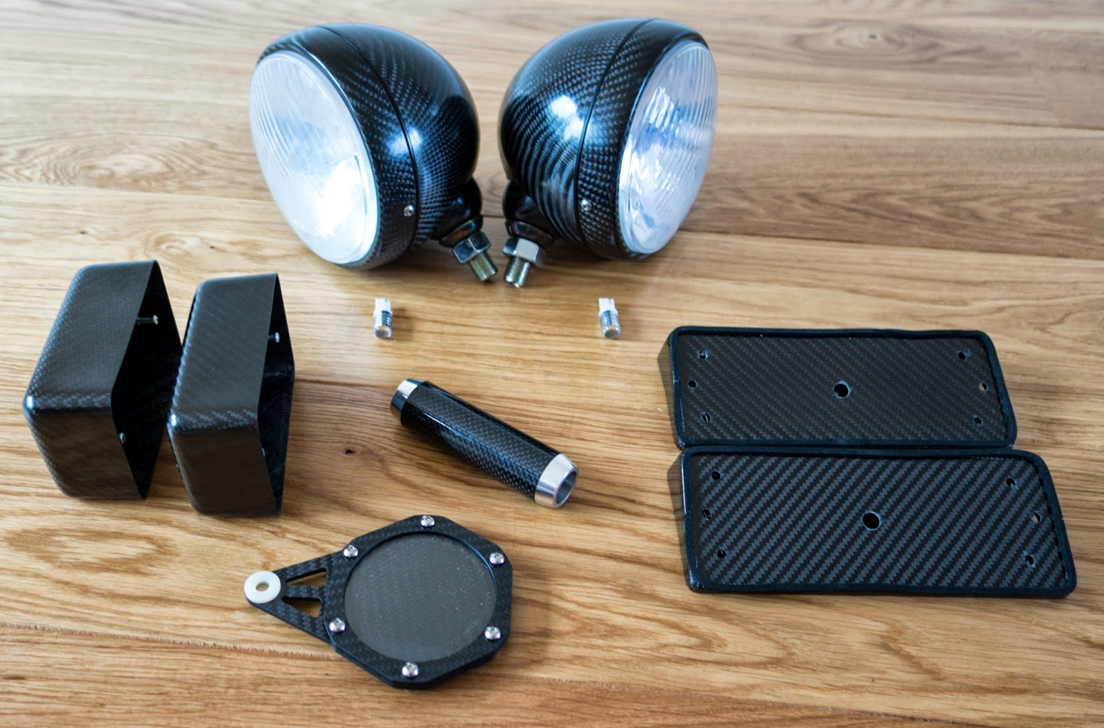 Caterham carbon accessories including headlights, rear light blocks, handbrake lever and tax disc holder