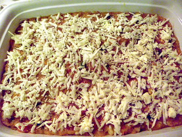 casserole in dish ready to bake
