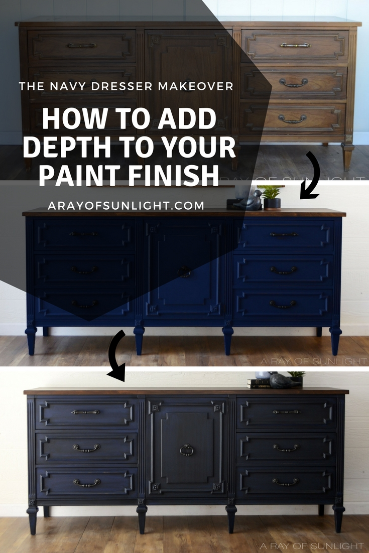Navy blue dresser makeover into a TV stand by removing the drawers to create shelving. Then it was antiqued with glaze to deepen the color and create a unique finish. By A Ray of Sunlight #furnituremakeover #furnituretransformation #upcycledfurniture #navyfurniture #paintedfurniture #tutorial #howto #glazedfurniture #antiqued