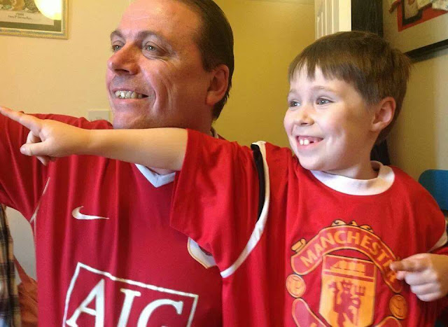Man and Boy in Matching Football Shirts