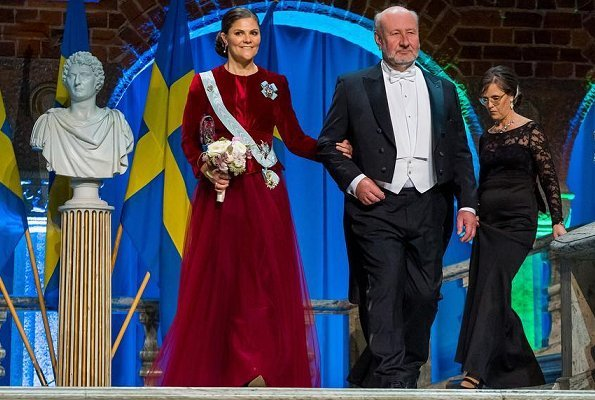 Crown Princess wore a scarlet gown made up of a full tulle skirt and a red velvet bodice,