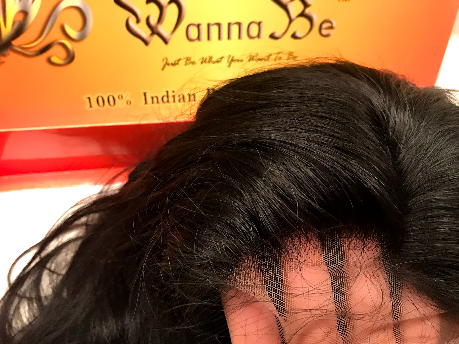 Image: Woman showing the front of the hairline on her beauty store bought wig.