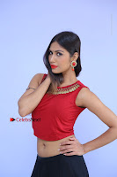Telugu Actress Nishi Ganda Stills in Red Blouse and Black Skirt at Tik Tak Telugu Movie Audio Launch .COM 0045.JPG